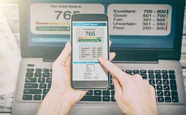 checking credit score on phone and computer