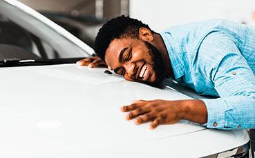 Guy hugging his new car