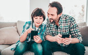 Dad and son using phone