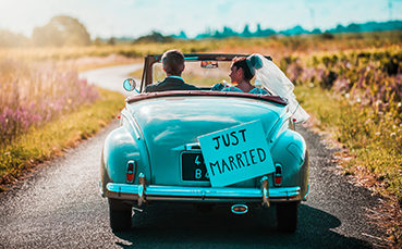 Just married couple driving off